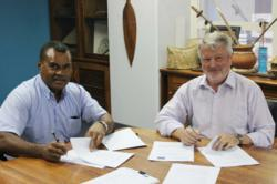SPTO CEO Ilisoni Vuidreketi and WHL Group CEO Len Cordiner sign a contract in Suva, Fiji