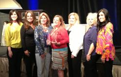Pam Wade and the Gables Corporate Accommodations Team accepting Tower of Excellence Award for Company of the Year and Pam Wade as Individual of the Year
