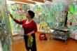 "Vivian Reiss in her studio working on her ""Garden Series"""