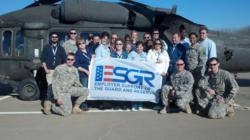 Steve Otero, Security America Mortgage Public Relations Director, poses for a photo with Army Gurad and Reserve Soldiers at Hood Army Airfield, Tx, Feb. 5.