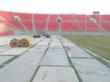 Pro-Turf International Had to cover the entire artificial turf with plastic before rolling out the thick cut sod onto Sam Boyd Stadium for the 2013 Rugby Sevens Event in Las Vegas.