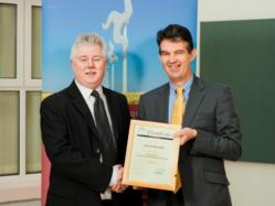 Kevin Burnell (left) director of ISO QA Ltd after receiving his Certificate in Energy Management Principles from Laurence Skelly MHK