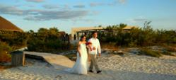 Walking down the &quot;sandy aisle&quot;  to exchange wedding vows on the beach