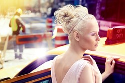 Spring's No Effort Hairstyle: A messy high bun with texture and accented with a headband.