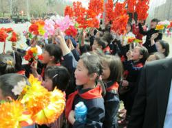 North Korean children celebrate at a parade honoring Kim Il Sung