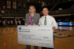 PC Women's Basketball coach Susan Robinson Fruchtl accepts a $2,500 donation from Rhode Island Medical Imaging presented by Dr. Scott Levine.