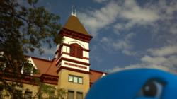 Lakeland College's new Musko mascot photobombs a promotional shot of Old Main.