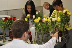 Assembling floral bouquets to benefit Royal Family KIDS