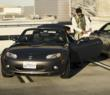 FlightCar Team Member helps customer get into Mazda Miata