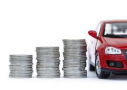Picture of a stack of coins next to a car