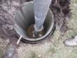 Caisson installation using hydro-excavation