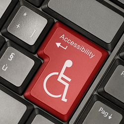 Keyboard with the return key replaced by a disability graphic.