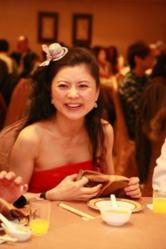 Matchmaker Extraordinaire Hellen Chen joins in the celebration of another newly wed