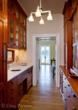 Custom millwork in the butler's pantry is detailed in 21st Century Arts and Crafts Style.