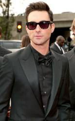 Adam Levine impresses in an all-black look by designer Tom Ford.