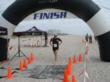 Matt Wisthoff, Team Relay Champion, 2012 and 2013, Bike Cycles of Wilmington, runs across the finish line