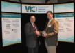 "Mitch Horowitz, VP of Battelle Technology Partnership Practice, receives a globe representing VIC's ""Technology Solutions for a Better World"" from Calvin Goforth, CEO of VIC™."