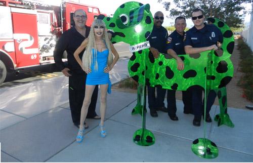 "Karen & Tony Barone Pose With Local Firemen & ""R.HERO"" Sculpture"