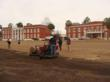 ABAC historic halls, during dormant TifBlair Centipede installation. In the Southeast, sod is easily and successfully installed when dormant.