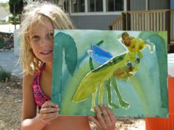 A Happy Camper at Highland Hall Shows off Her Art