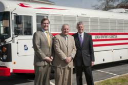 From left: Bart Gorbeil, chief operating officer with the State of Georgia; Brian Owens, commissioner of the Georgia Department of Corrections; and Phil Horlock, president & CEO of Blue Bird, in front of the first 2014 All American Blue Bird bus.