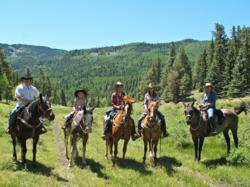 Families spend time on horseback together at a Colorado dude ranch