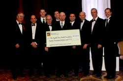 Georgetown oral surgeons presenting the $20,000 check to the Capital Area Dental Foundation