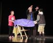 Magician Steffan Soule performing about Golden Rule for school assemblies