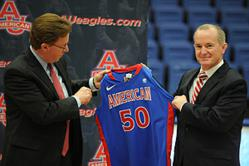 AU President Neil Kerwin presents new AD Billy Walker with an AU basketball jersey.