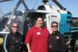 Fremonts Mayor Bill Harrison poses for a photograph with a CALSTAR helicopter pilot and Paul Afshar, CEO of Unitek Information Systems.