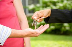 Home Buyers and Sellers Exchanging Keys