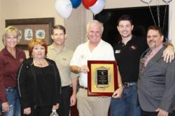 RE/MAX Southern Realty Agent James Gilliland named number five commissions paid team in Florida for 2012. Pictured: James Gilliland (holding plaque), his team and RE/MAX Southern Owners and Brokers Kerry Veach and Brad Shoults