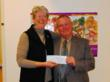 Mary Meyer of Kids Cook! accepts a check from AAM's Ken Inskeep.