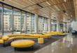 The MassArt Residence Hall's stylish lobby designed by ADD Inc features yellow Maroso sofas that echo the organic shapes of the outside benches.