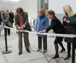 Hypertherm's Founder and New Hampshire Governor use a Powermax30 to cut the ribbon.