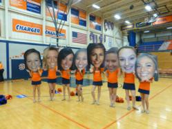 Cheerleaders show off their Big Heads created by Shindigz at Pep Rally