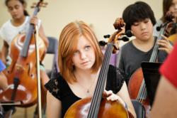 Students learning to play string instruments during 8th grade music class at this private school in Pasadena