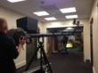 Camera operators capture images inside the hospital.