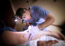 Dr. Motew is shown here performing a varicose vein treatment on a patient.