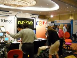 RESNA conference exhibit hall picture showing people and booths
