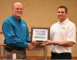 Jason Borawski (left) completes The Grounds Guys franchise training. Pictured with Ron Madera, President of The Grounds Guys