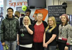 The Thompson family with students and Havering College student development worker Kelly Phillips