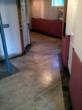 Concrete floor staining project using tape to form a pattern.