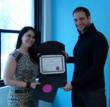 "Certified F.A.B.U.L.O.U.S. Site Director Jessica Jacques presenting ""Certified F.A.B.U.L.O.U.S. Seal of Approval"" to Joshua Gordon, Founder and CEO of NOYA"