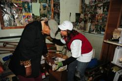 Hope Force Int'l volunteer helps a homeowner clean her flooded house after Hurricane Sandy.