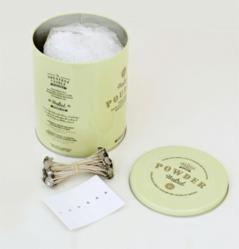 A typical kit to make candles from used cooking oil includes a bag of candle powder, cotton wicks and wick stabilizers.