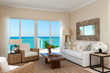 Beautifully furnished living rooms offer oceanfront views of Grace Bay.