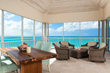 Screened in patios offer amazing views of Grace Bay beach.