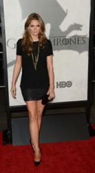 "Stana Katic carries the Jill Milan Holland Park Clutch to HBO ""Game Of Thrones"" season 3 premiere in Hollywood, March 18, 2013. (Photo: Jason Merritt, Getty Images)"