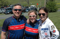 Michael Harris with Amanda Jacob and Rachel Jacob of Team Booz Allen Hamilton.